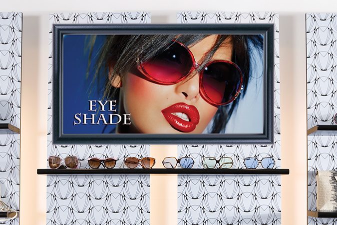 Stylish women's sunglasses and handbags for sale on display shelves in store